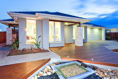Modern mansion with wooden floor and concrete yard and stone dec Stock Photo