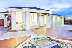 Modern mansion with wooden floor and concrete yard and stones Royalty Free Stock Photo