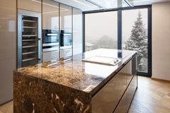 Modern marble kitchen with island royalty free stock photos