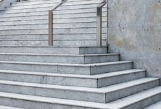 Modern marble staircase of the municipal administrative building with stainless steel handrails. Stock photo royalty free stock photo