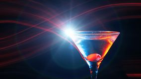 Modern martini cocktail with yellow olive in glass stock video footage