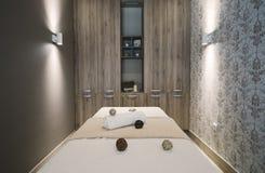Modern massage room with beautiful interior. Modern beautiful massage room at beauty saloon stock photos