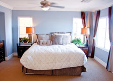 Modern master bedroom. With bed stock photo