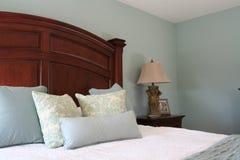 Modern Master Bedroom. Green master bedroom in a modern decor Stock Photos