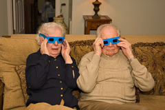 Modern Mature Couple. Elderly couple wearing 3d paper glasses Royalty Free Stock Image