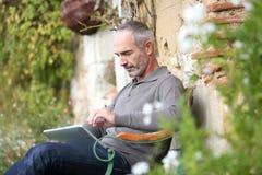 Modern mature man enjoying country house Stock Photos