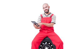 Modern mechanic using wireless tablet or pad Stock Photos