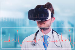 Modern medic with virtual reality goggles. Looking at electrocardiogram on futuristic screen royalty free stock photos