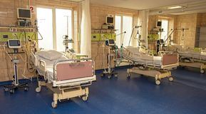 Modern medical bed and a special device in the modern ward of re. Suscitation in the hospital patient recovery, death - concept stock photography