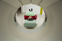Modern medical equipment, preventional medicine and healthcare.Computer tomography scan.Old woman patient. At computerized axial tomography (CAT) scan.Examining Royalty Free Stock Photography