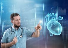 Modern medicine cardiology concept. Handsome male doctor royalty free stock photos
