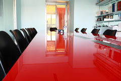 Modern meeting room. Red table in modern meeting room Stock Photos