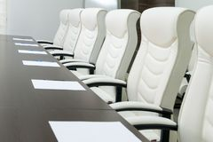 Modern meeting room. Empty modern meeting room with armchair stock photography