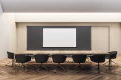 Modern meeting room with frame. Modern black wooden meeting room interior with empty white frame and furniture. 3D Rendering royalty free illustration