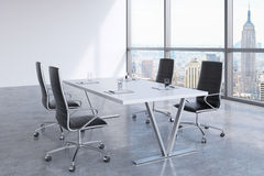 Modern meeting room with huge windows looking at the New York City, Manhattan. Stock Photos