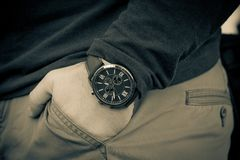 Modern men`s watch, brown-gold color. In close up shot Royalty Free Stock Images