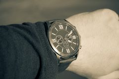 Modern men`s watch, brown-gold color. In close up shot Royalty Free Stock Photography