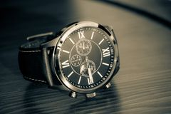 Modern men`s watch, brown-gold color. In close up shot Stock Photo