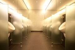 Modern mens club bathroom Stock Photography