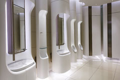 Modern mens restroom in an upscale shopping centre Stock Photos