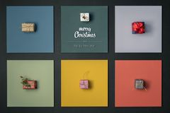 Modern merry Christmas and happy new year greetings in vertical top view colorful frames with gift present boxes design. Xmas winter holiday season social media stock images