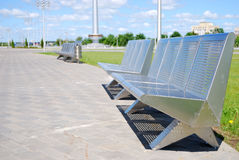 Modern metal benches. On sidewalk Royalty Free Stock Photography