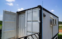 Modern metal building made from shipping house containers and blue sky background.  royalty free stock image