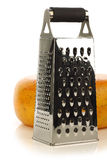 Modern metal cheese grater and a whole edam cheese Stock Photo