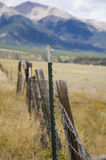 Modern metal Fence post and wooden old posts Stock Images