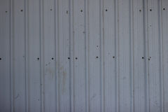Modern metal fence from prefabricated panels texture Royalty Free Stock Photos