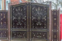 Modern metal gate near a apartment house Stock Image