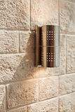 Modern metal lamp on ashlar wall pattern Stock Photo