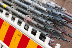Modern metal scaffolding details lay behind barrier Stock Photo