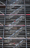 Modern metal scaffolding near the wall Royalty Free Stock Photo