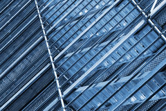 Modern metal scaffolding on wall, blue toned Royalty Free Stock Images
