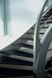 Modern metal staircase. With dark grey wooden stairs Stock Photos