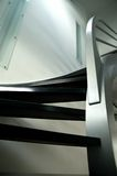 Modern metal staircase. With dark grey wooden stairs Royalty Free Stock Photos