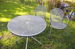 Modern metal table and chair in park Stock Images