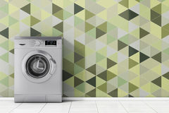Modern Metalic Washing Machine in front of Olive Green Geometric Royalty Free Stock Photos