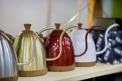 Modern metallic colorful teapots for filtered coffee, cafe shop stock photo
