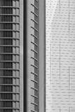 Modern metallic and glass building facade in black and white Royalty Free Stock Photos