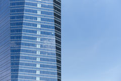 Modern metallic and glass building facade in blue tone Stock Photography