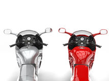 Modern metallic silver and red motorbikes - FPS view Royalty Free Stock Image