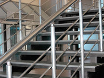 Modern metallic stairs. (bright photo Stock Photography