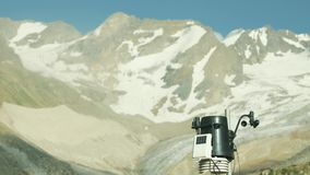 Modern meteorological equipment on weather station in snow mountains