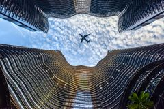 Modern Metropolis Financial Center With Flying Plane stock images