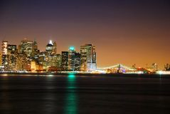 Modern Metropolis, New York City. At night over Hudson River with Brooklyn Bridge royalty free stock photo