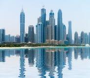 Modern, Metropolitan Skyline, Reflected in a Tropical Bay Stock Photos