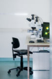 Modern microscope station out of focus Royalty Free Stock Image