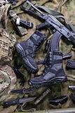 Modern military boots and weapon.Top view Royalty Free Stock Images